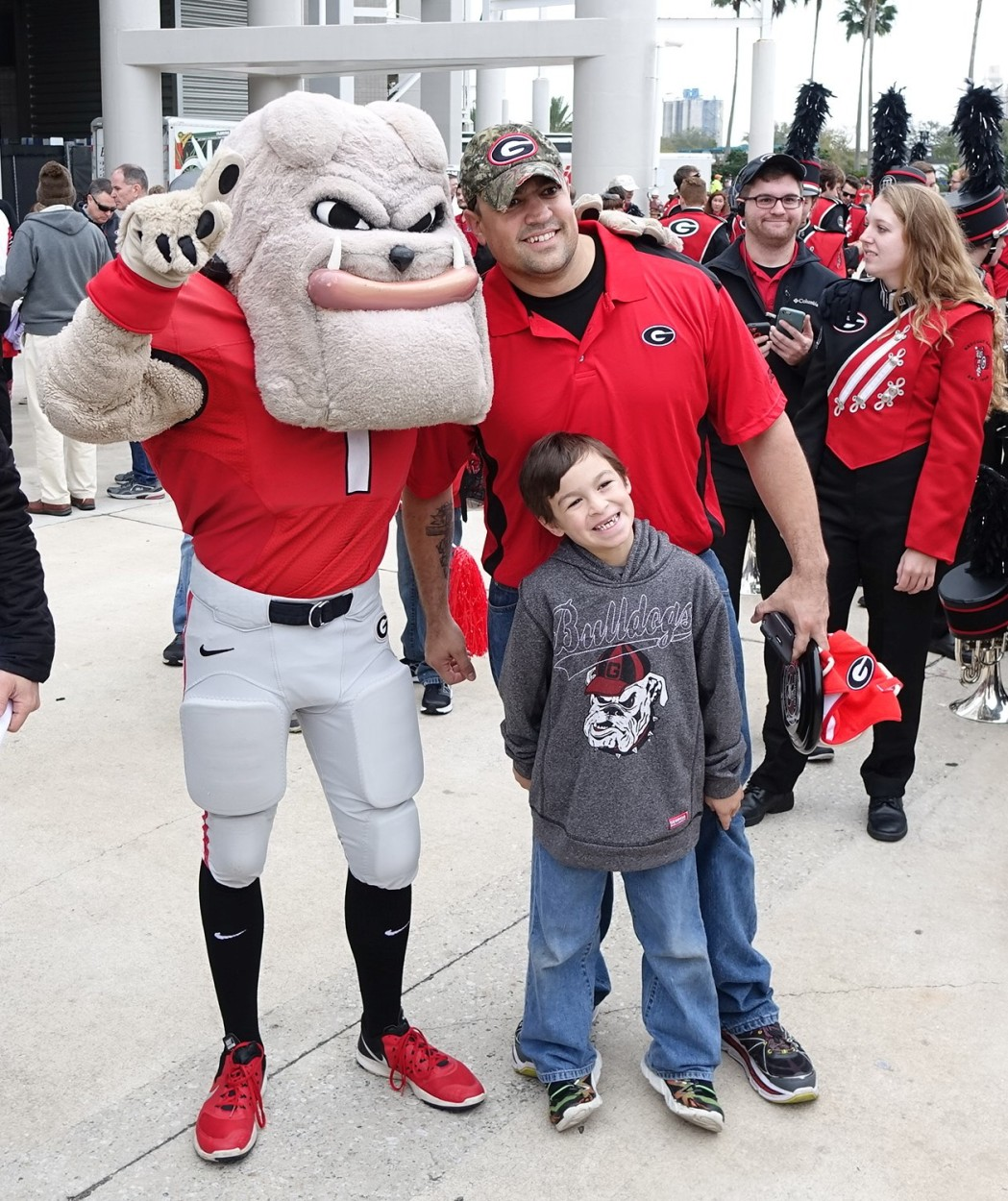 Hairy Dawg always eager to pose with fans for a photo op - Dawg Walk - TaxSlayer Bowl - 02-JAN-2016 (Photo by Greg Poole)