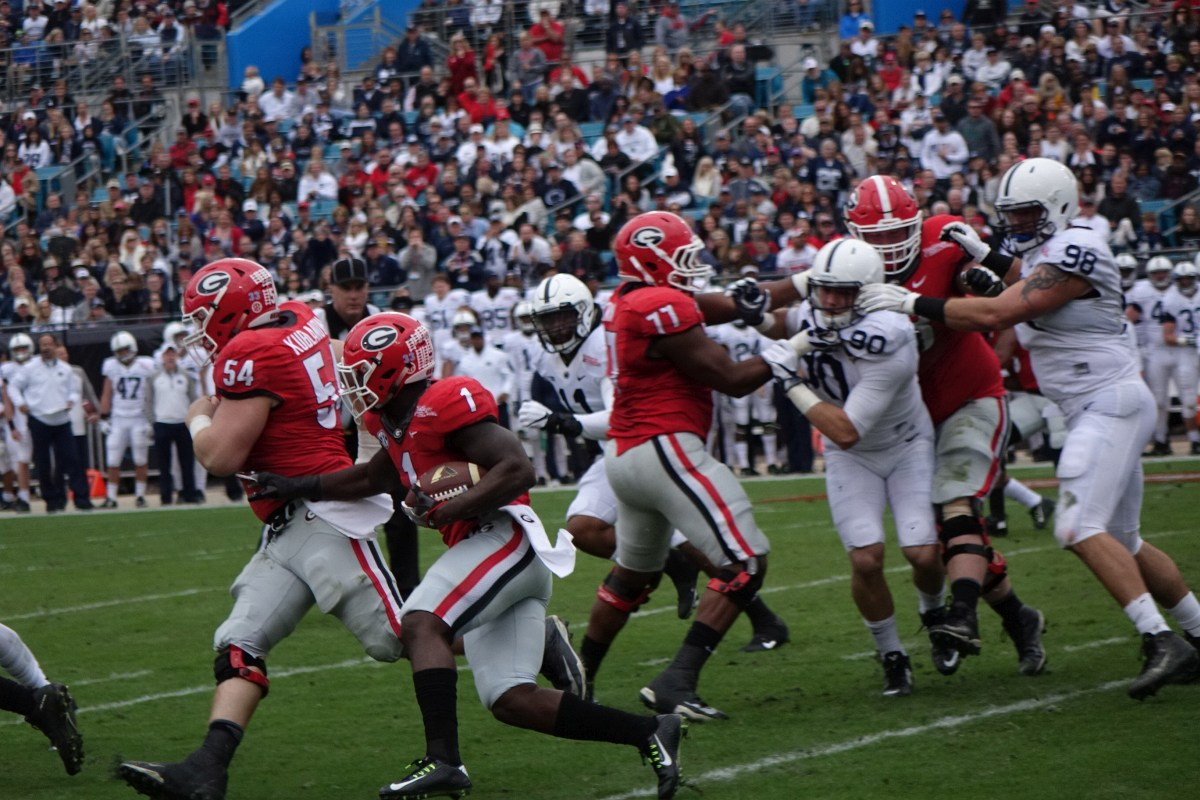Sony Michel runs behind No.54 center Brandon Kublanow and his offensive line - 1st half TaxSlayer Bowl 02-JAN-2016 (Photo by Grege Poole