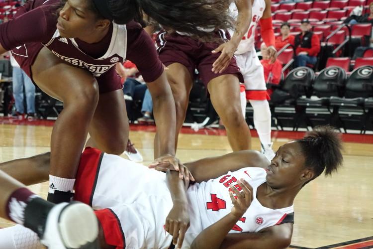 Caliya Robinson fights for the rebound
