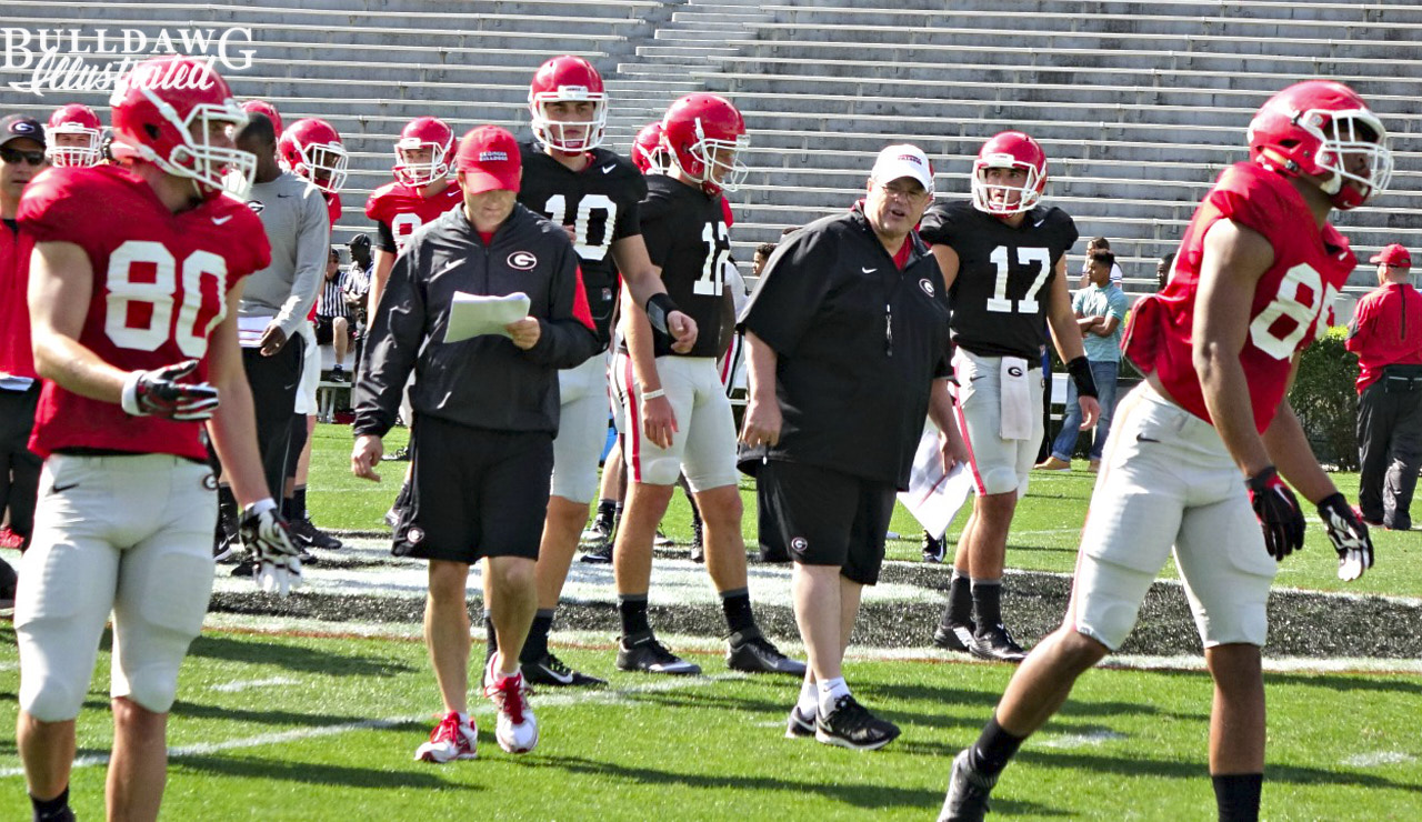 Offensive coordinator Jim Chaney oversees a drill