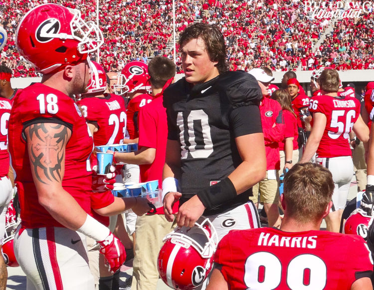 Jacob Eason (10), Isaac Nauta (18) and Jackson Harris (88)