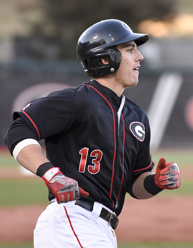 Georgia catcher Michael Curry (13) runs to first base during an NCAA baseball game between Georgia and Georgia Southern at Foley Field in Athens, Georgia on Friday, Feb. 19, 2016.