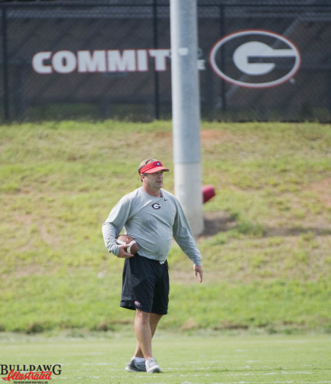 Coach Smart watching the defensive backs