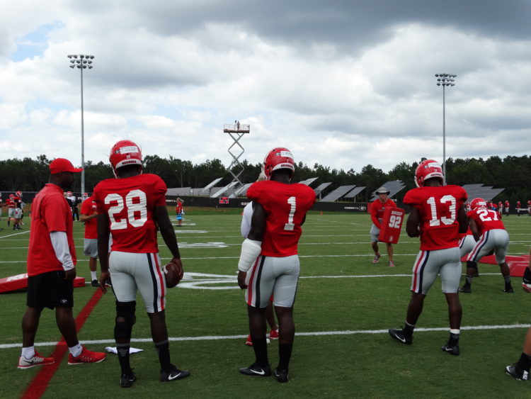 Shaquery Wilson, Sony Michel, Elijah Holyfield, and Nick Chubb during footwork drills
