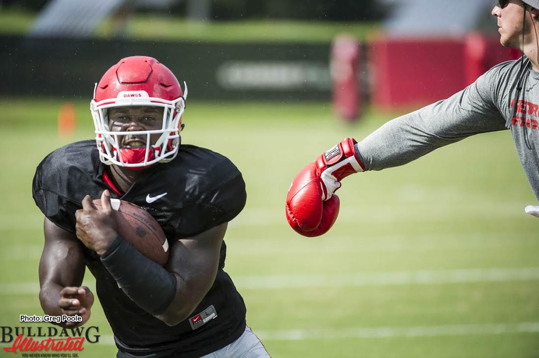 RB Sony Michel goes through ball security drills during Tuesday's practice