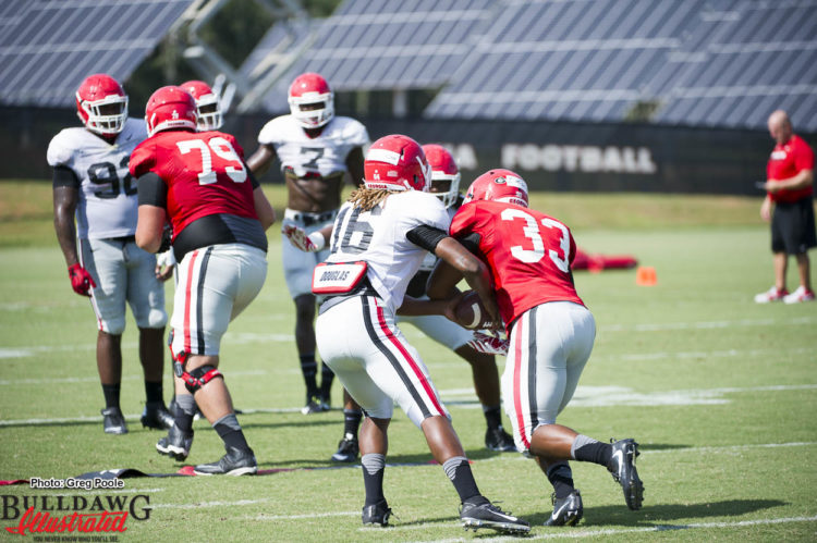 Caleeb Roberson (16) acting as QB to give UGA defense a spread option look in this drill