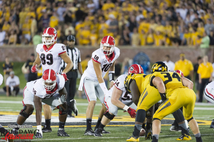 Jacob Eason (10) orchestrating a 4th quarter game winning drive