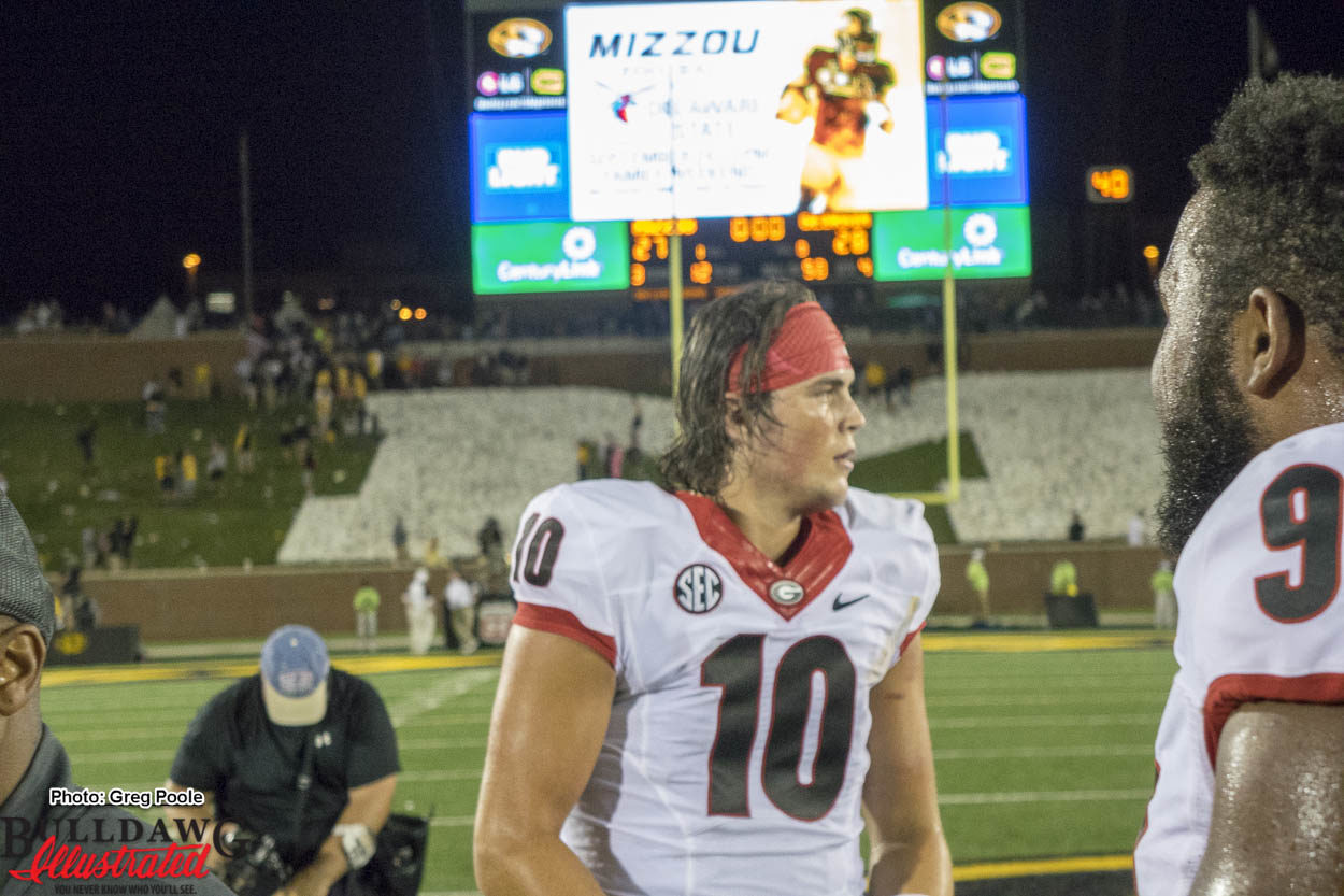 QB Jacob Eason celebrating with team after come from behind win