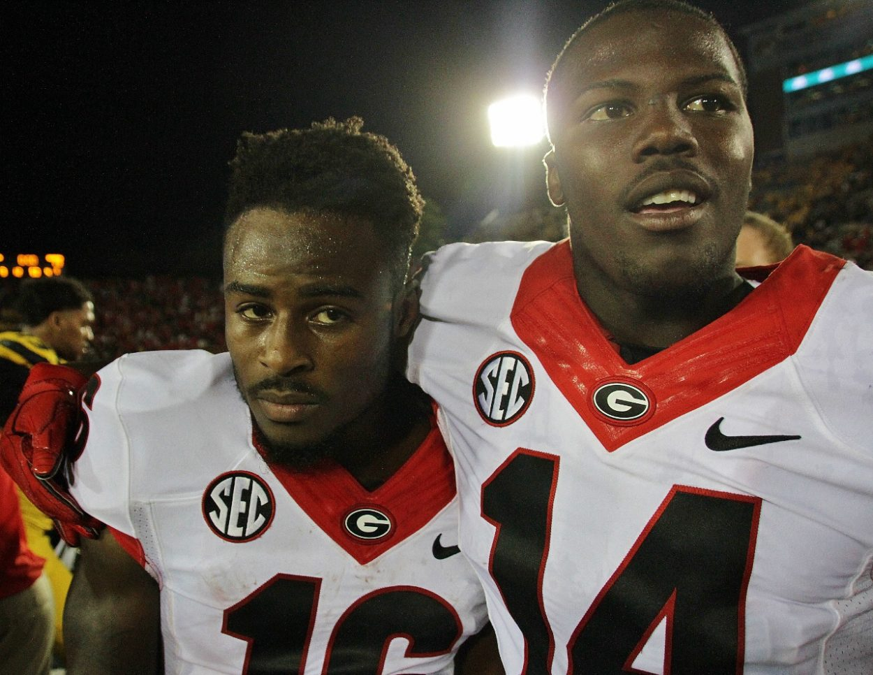 Isaiah McKenzie and Malkom Parrish celebrate the win (photo by Rob Saye)