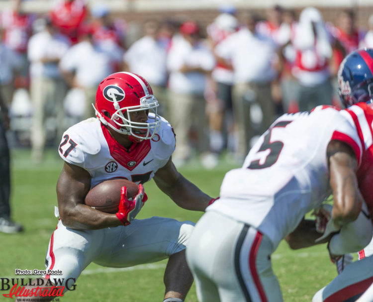 Nick Chubb (27) looks for some running room