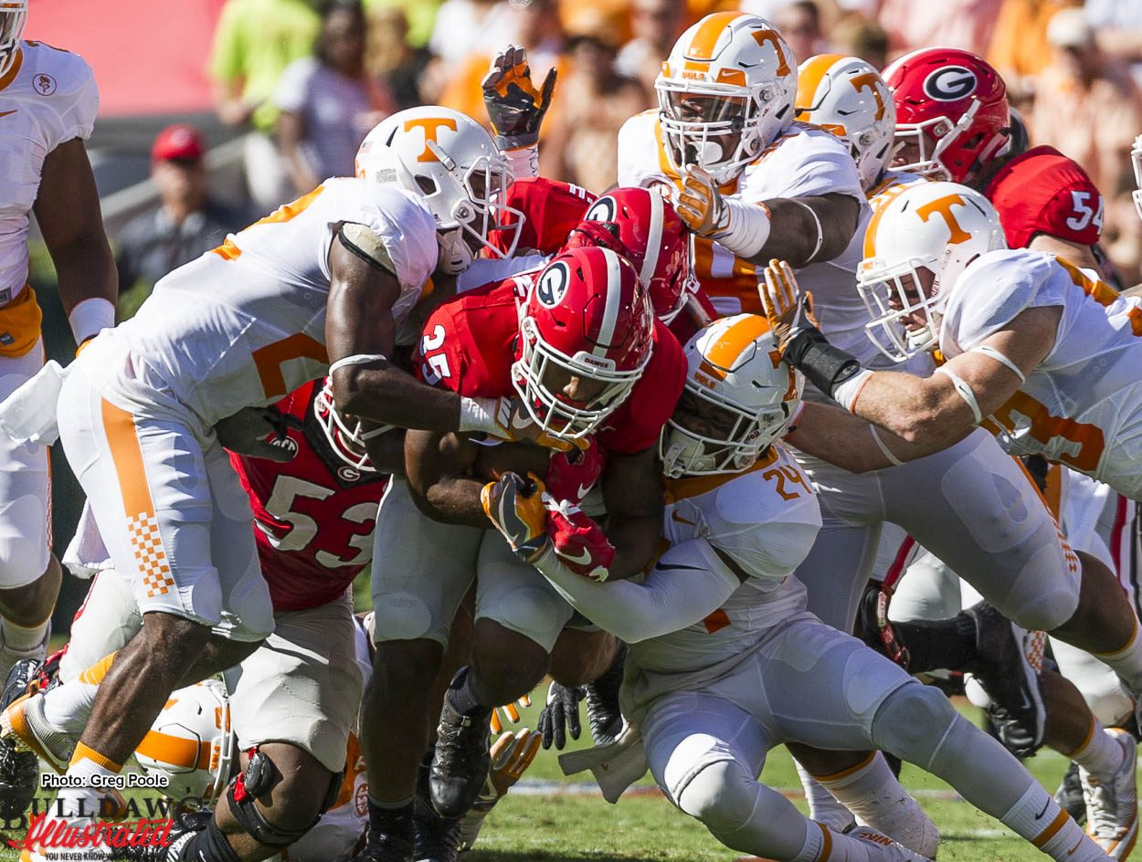 Brian Herrien appears to drag the entire Tennessee defense