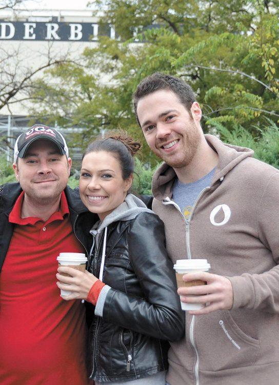 Chris Lee (pictured left) with his brother Mitch Lee and sister-in-law Katy at the 2013 UGA vs Vanderbilt game in Nashville