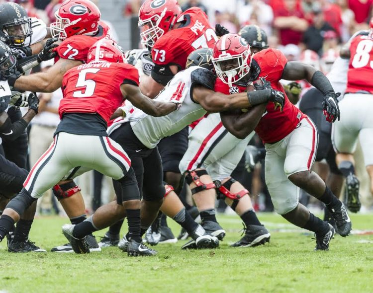 Tailback Sony Michel (1) fighting for every inch