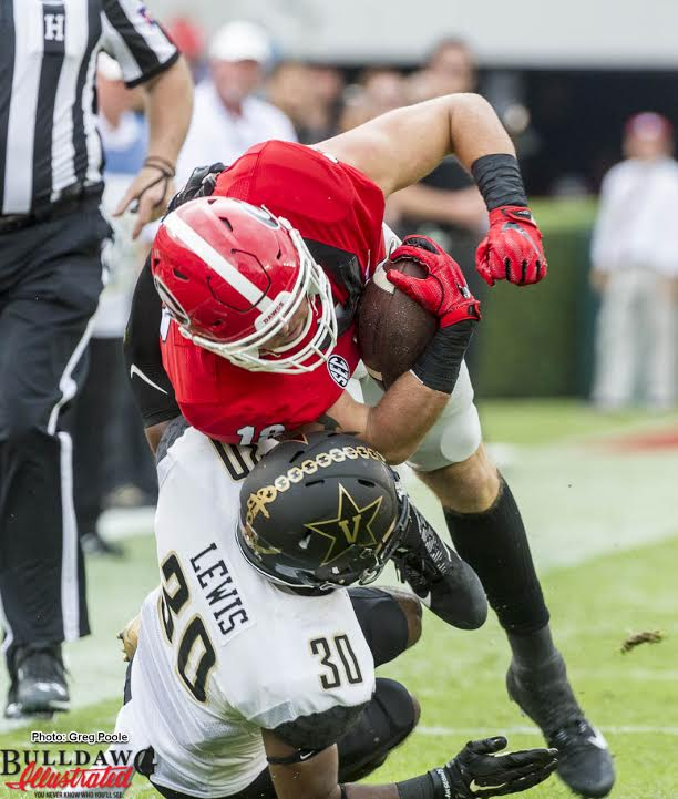 Isaac Nauta lowers his shoulder to pick up a few extra yards.