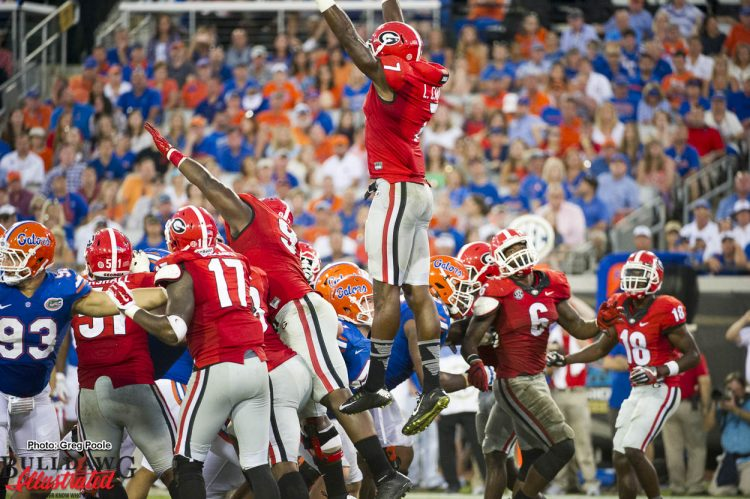 Lorenzo Carter (7) getting some air