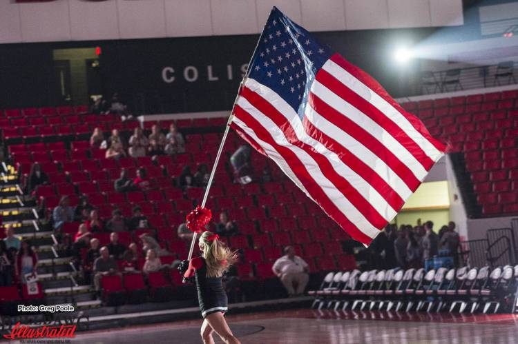 Georgia cheerleaders display the American flag Stegeman Coliseum on Veterans Day