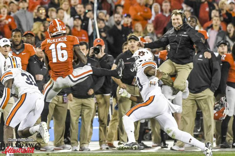 Isaiah McKenzie (16) with a spectacular catch - Kirby Smart with a spectacular sympathy leap