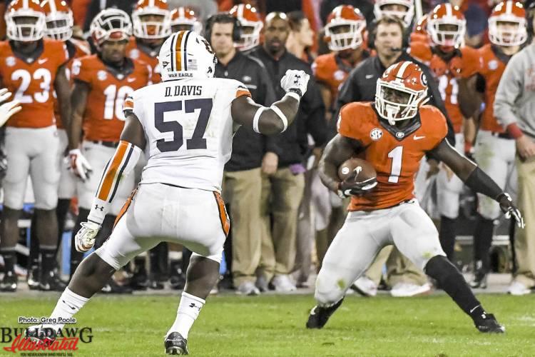 Sony Michel (1) takes on Tiger LB Deshaun Davis (57) - Georgia vs Auburn 12-Nov-2016