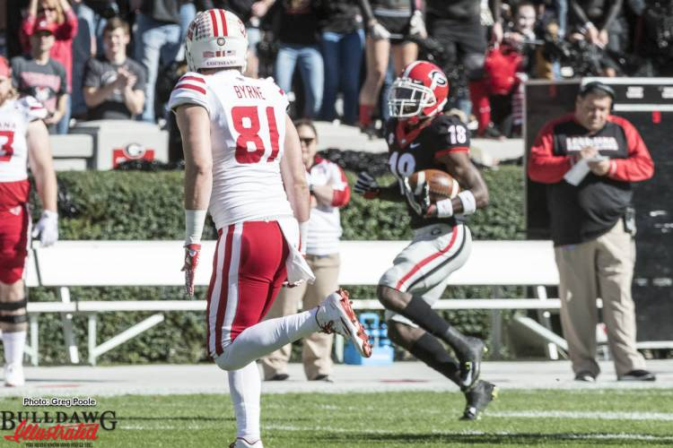 Deandre Baker (18) with the interception