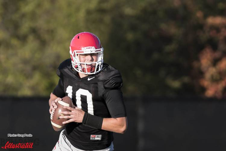 Jacob Eason(10) running through a practice drill during practice on Monday November 21, 2016.