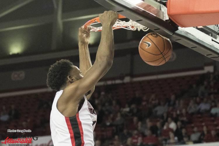 Yante Maten (1) dunks the basketball.