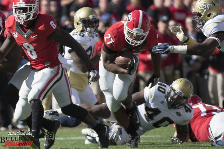 Nick Chubb powers through a hole