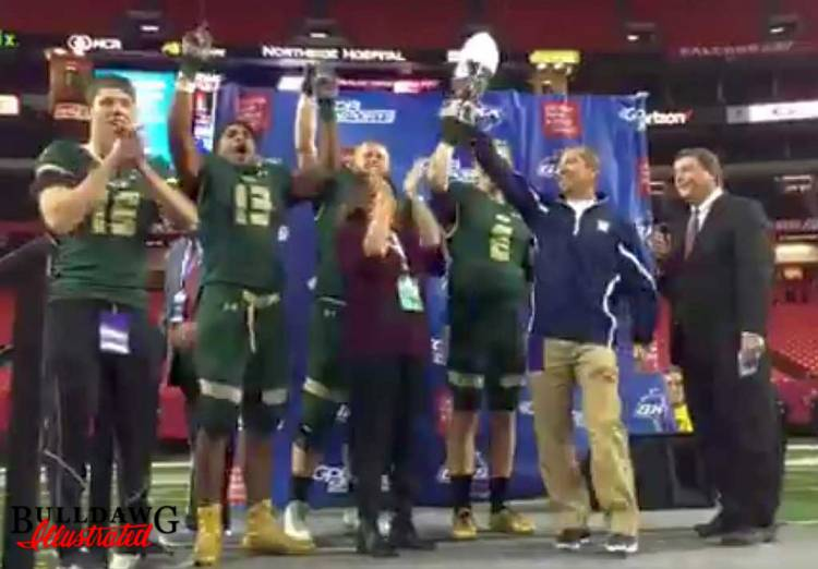 Grayson Rams football team is presented with the 2016 GHSA Class 7A Football State Championship trophy (photo by Bob Miller/Bulldawg Illustrated)