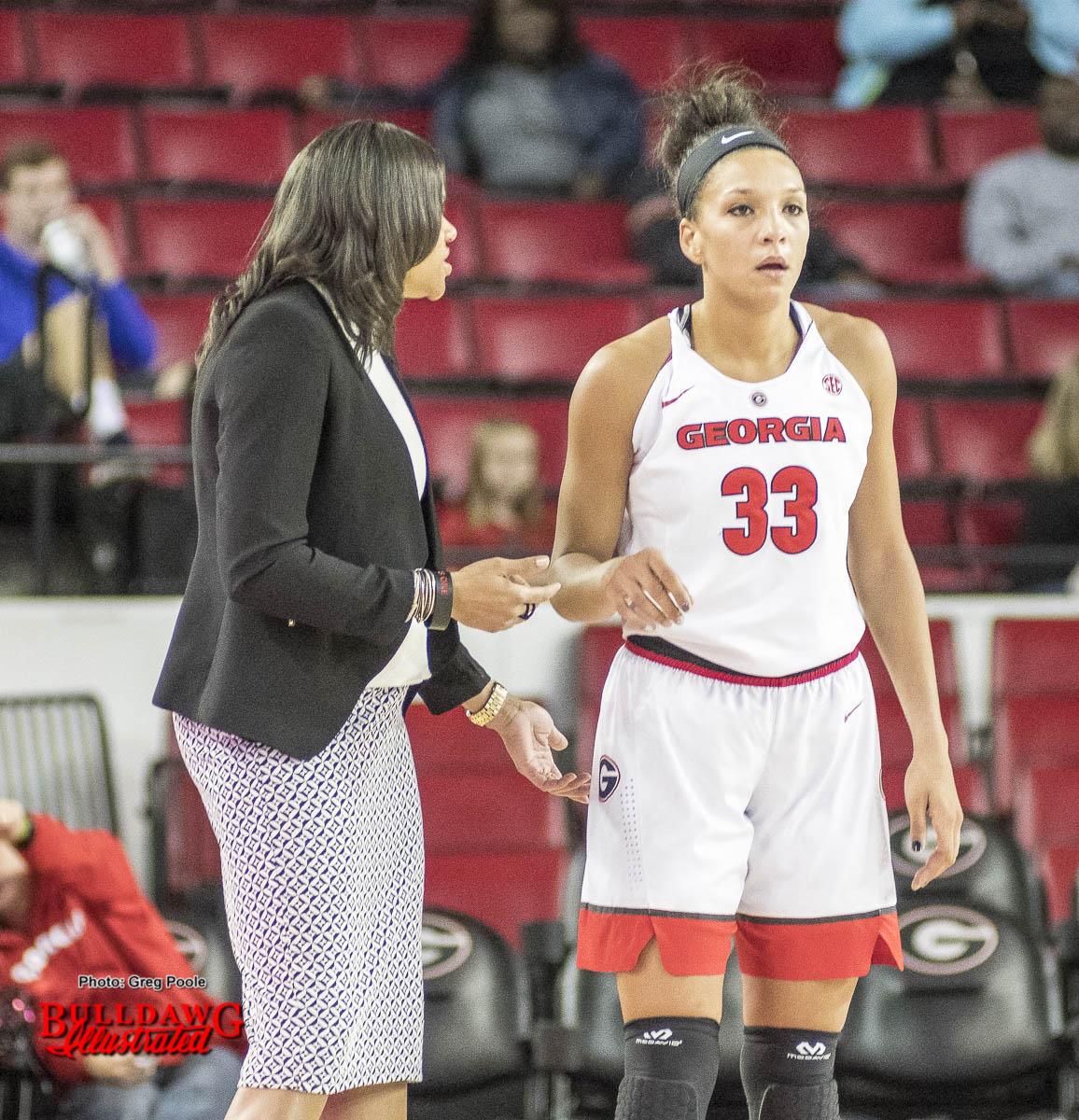 Coach Joni Taylor gives instructions to Mackenzie Engram
