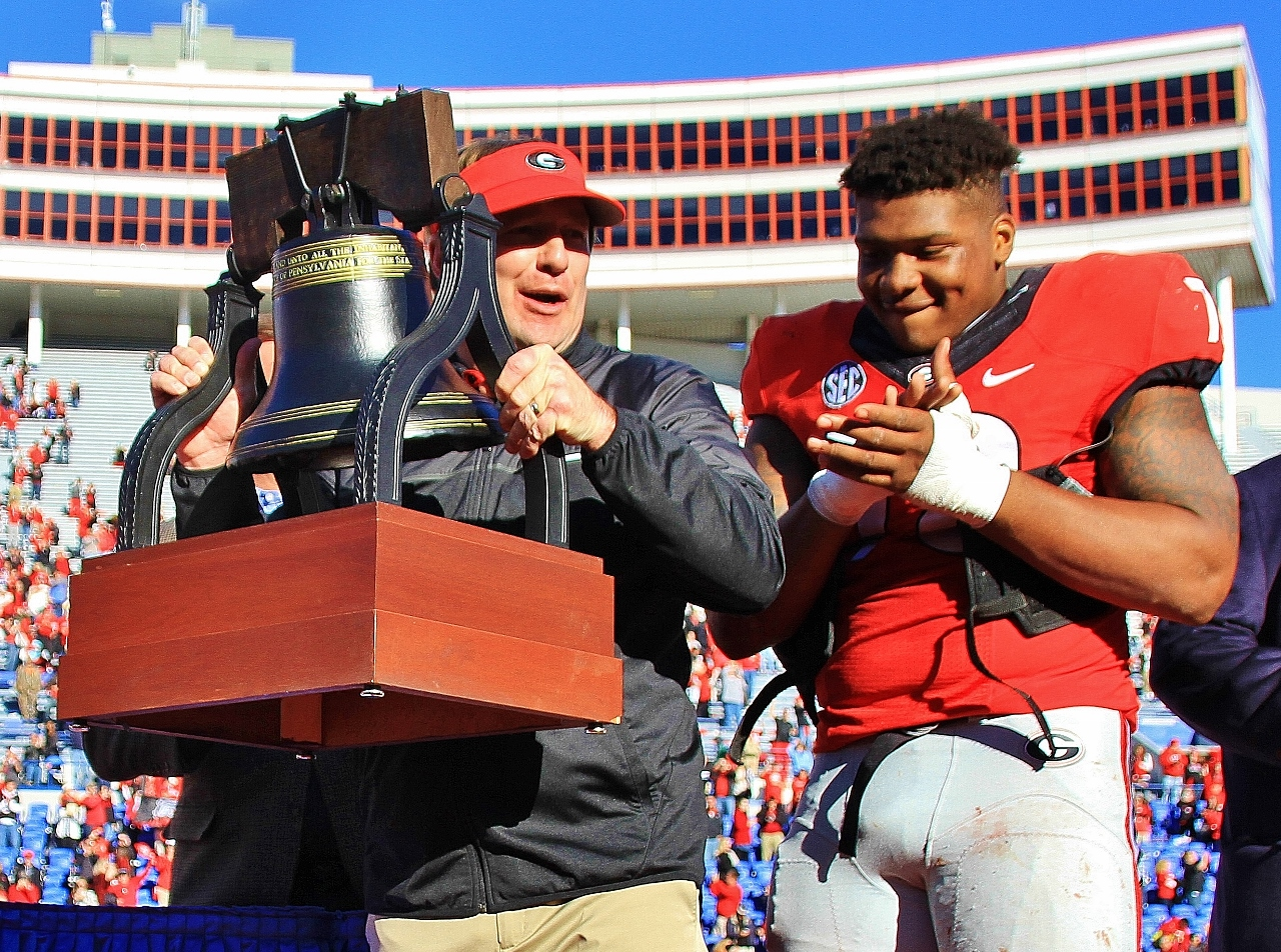 Kirby & Trent Thompson with the Liberty Bowl Trophy - Liberty Bowl - Dawgs 31 TCU 23