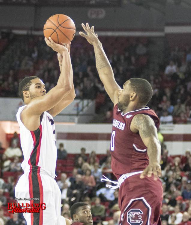 Juwan Parker shoots the ball over a South Carolina defender.