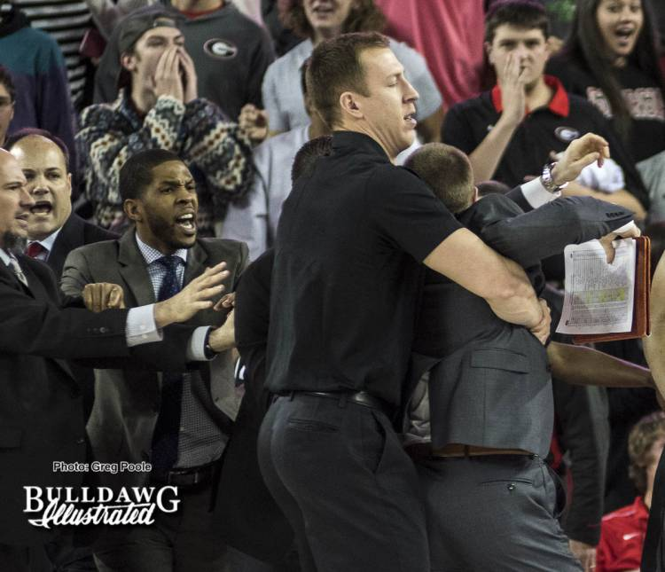 A Missouri assistant coach is restrained during the scuffle at the end of the first half of the UGA/Missouri game January 7, 2017