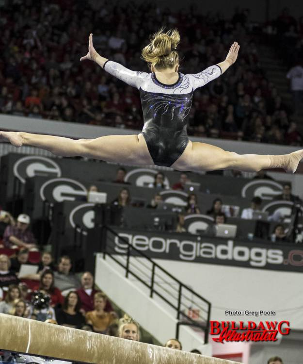 Hayley Sanders does a split leap on the beam.