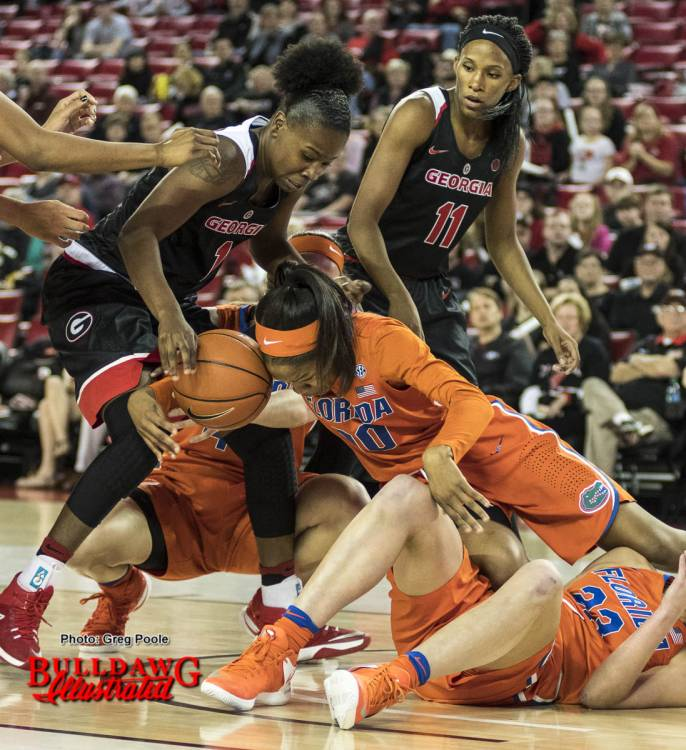 Shanea Armbrister (1) fights for a loose ball vs. Florida