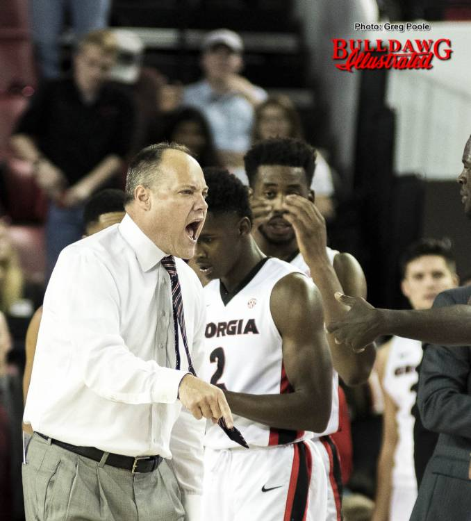 Mark Fox defends Jordan Harris (2) before being ejected as Yante Maten (1) looks on.