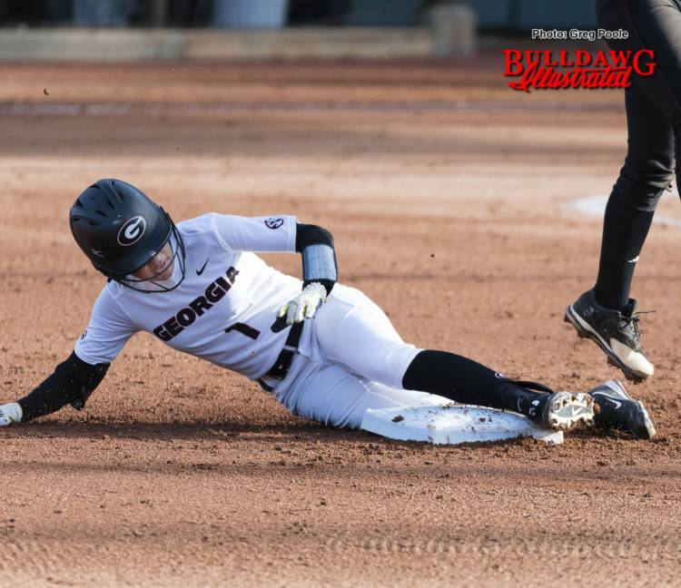 Cortni Emanuel is safe at 2nd base