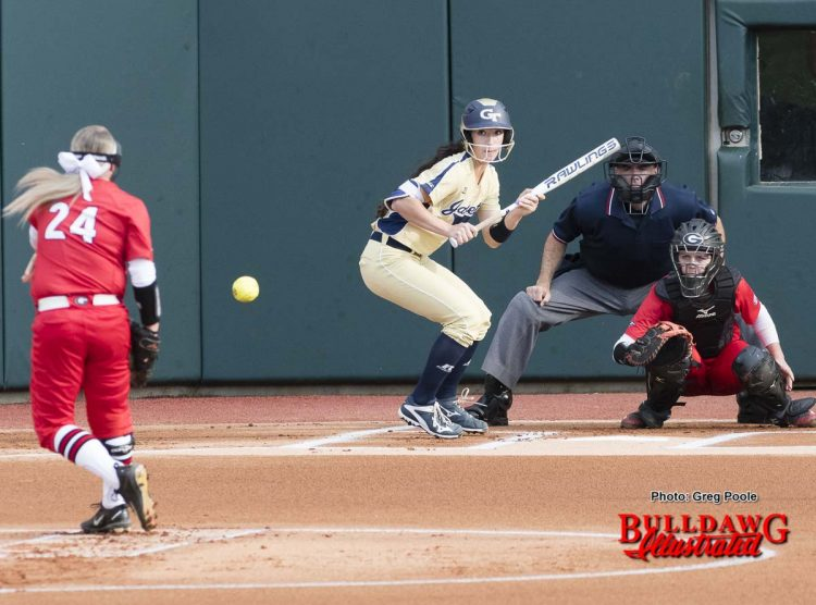 Kylie Bass (24) delivers to catcher Maeve McGuire