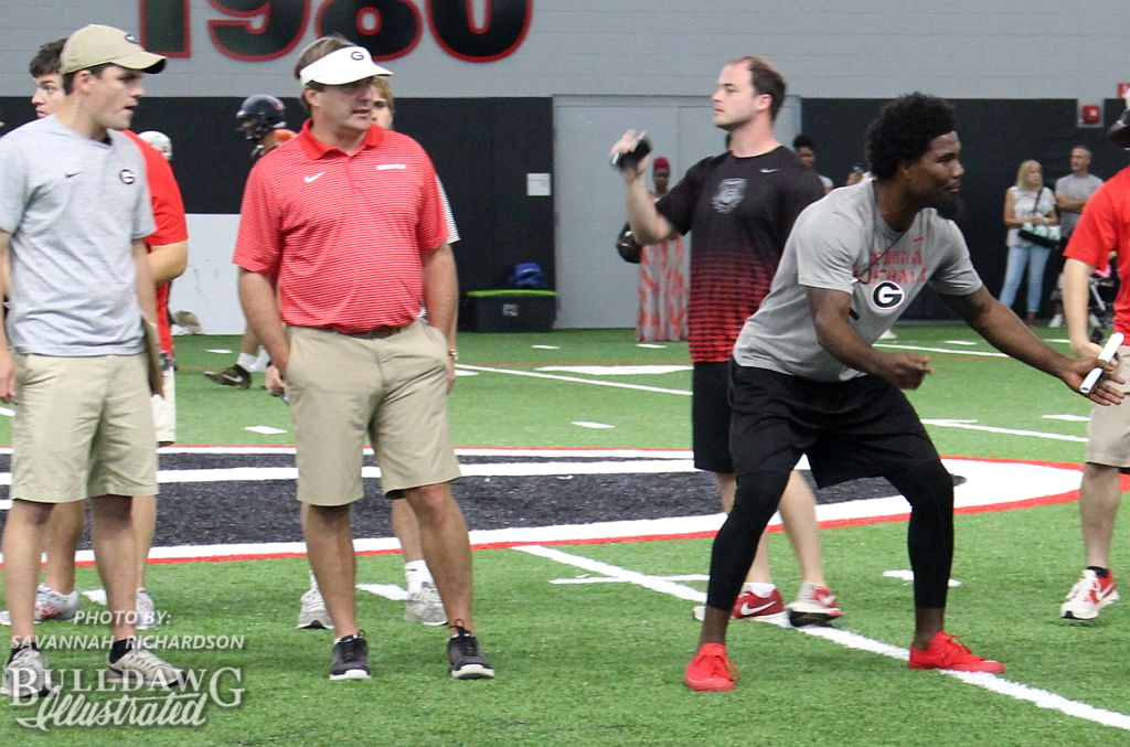 Georgia head coach Kirby Smart looks on as prospects work out at UGA on Friday