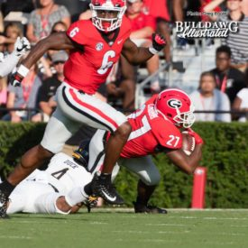 Javon Wims (6) looking for somone to block as Nick Chubb (27) is tackled by App State defender - Saturday, Sept. 2, 2017 -