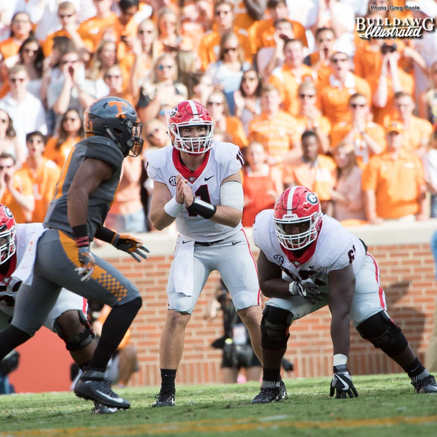 Jake Fromm (11) awaits the snap from Lamont Gaillard (53) as Kendall Baker (65) gets ready to put a hat on a Vol - 2nd quarter, UGA vs. Tennessee - Saturday, Sept. 30, 2017