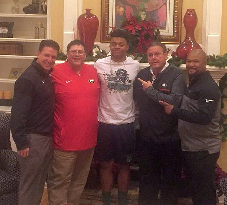 UGA WR Coach James Coley, Offensive Coordinator Jim Chaney, 2018 QB commit Justin Fields, O-Line Coach Sam Pittman, and RB Coachc Dell McGee. (Photo from Justin Fields / Twitter)
