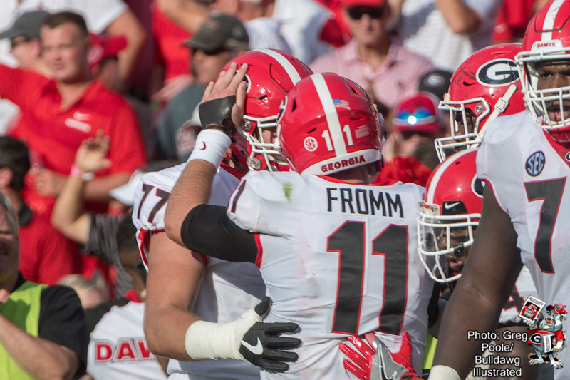 Jake Fromm (11) celebrates with Cade Mays (77) - Georgia vs. South Carolina 2018