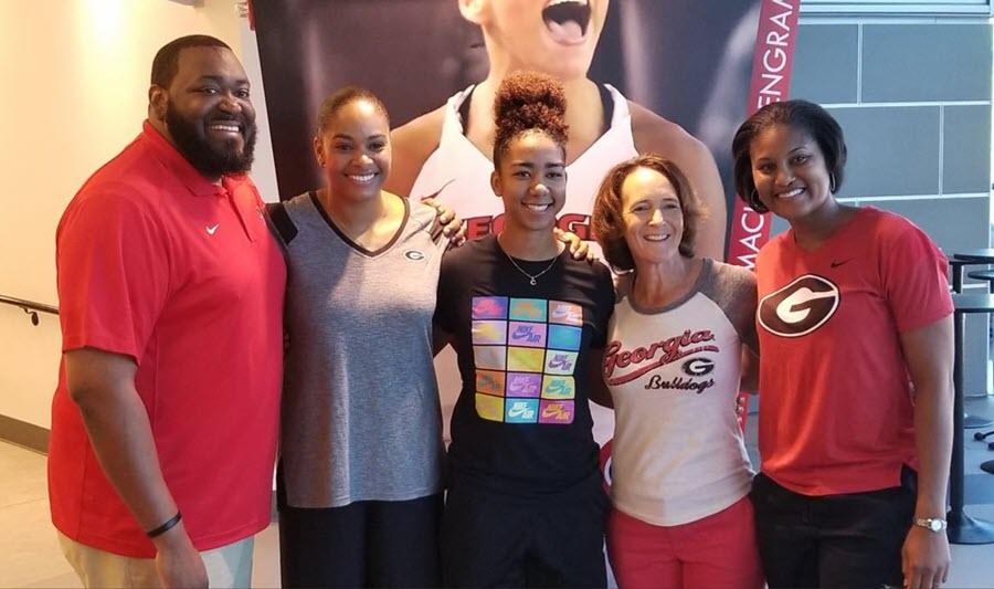 Chloe Chapman (center) with UGA staff