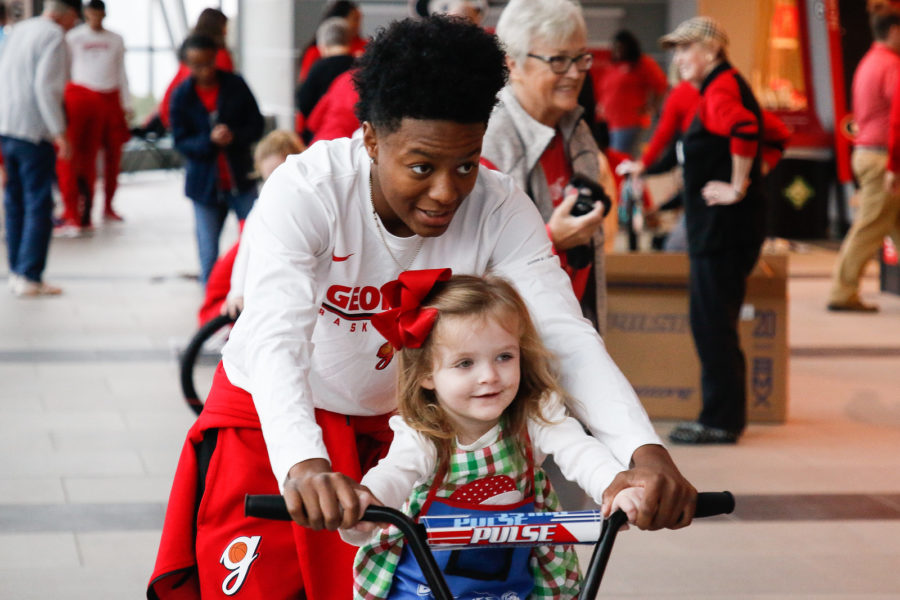 Georgia women's basketball players help assemble bikes in Stegeman Coliseum in Athens, Ga., on Saturday, Dec. 8, 2018. (Photo courtesy of Kristin Bradshaw, UGA Sports Communications)
