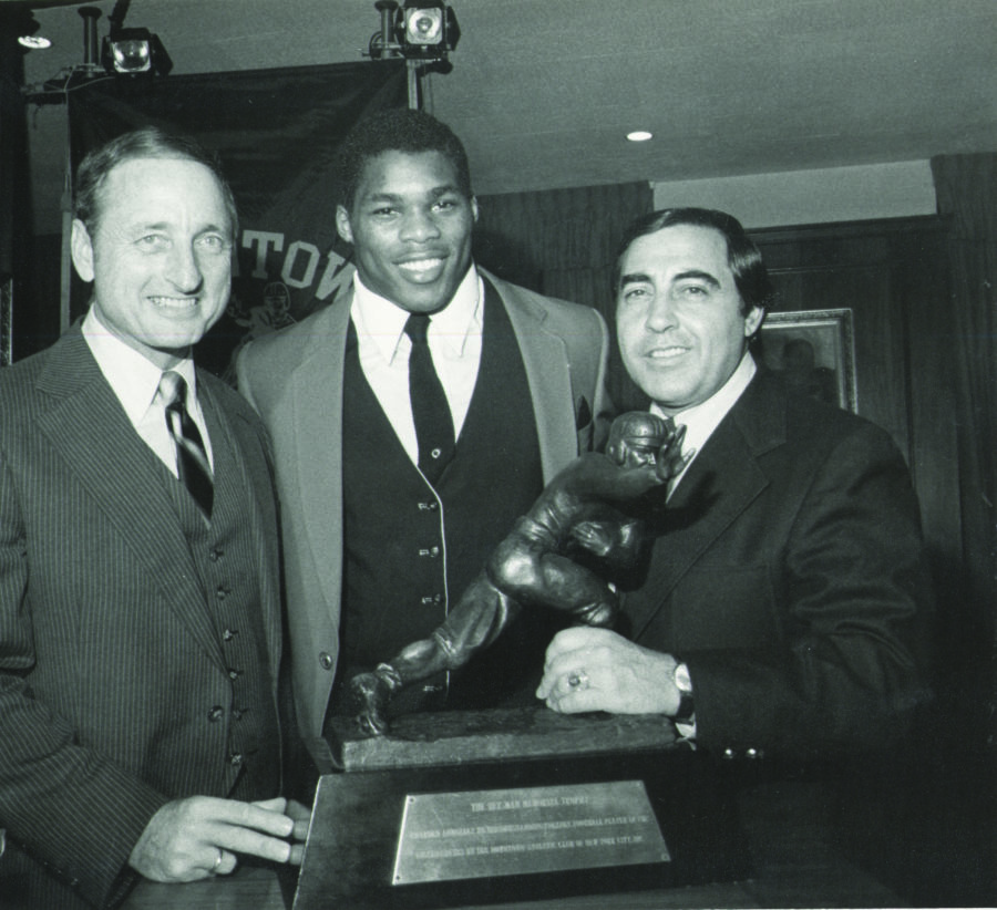 Vince Dooley with Herschel Walker poising with the Heisman Trophy, 1982.