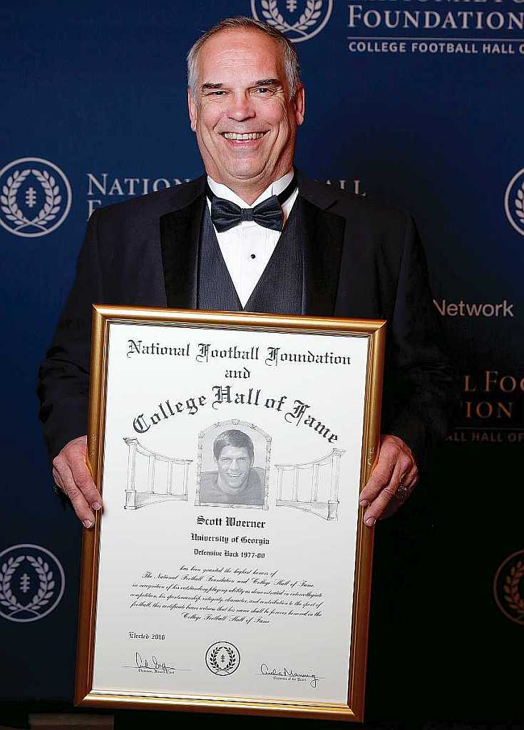 Scott Woerner with his College Foootball Hall of Fame plaque